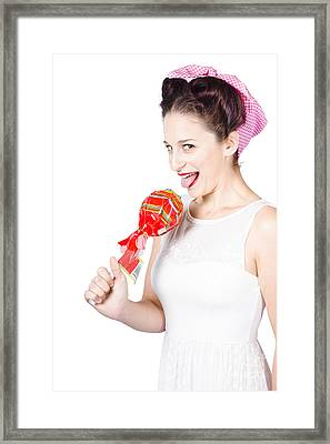 Brunette Pin Up Woman Licking Wrapped Lollipop Framed Print by Jorgo Photography - Wall Art Gallery