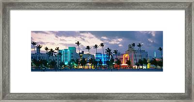 Buildings Lit Up At Dusk, Ocean Drive Framed Print by Panoramic Images