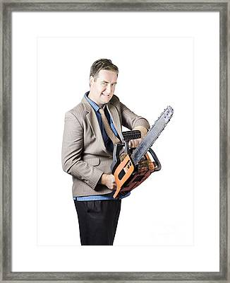 Businessman Holding Chainsaw Framed Print by Jorgo Photography - Wall Art Gallery