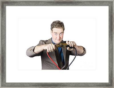 Businessman Holding Jumper Cables Framed Print by Jorgo Photography - Wall Art Gallery