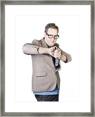 Businessman Holding Stapler Framed Print by Jorgo Photography - Wall Art Gallery