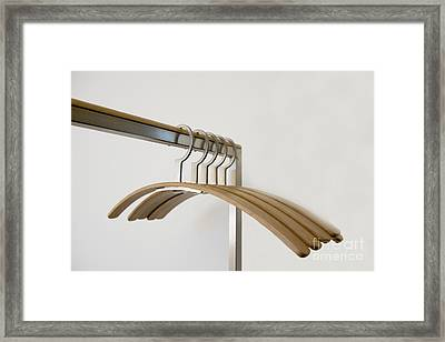 Clothes Hangers Framed Print by Mats Silvan