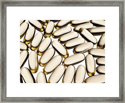 Cod Liver Oil Capsules Framed Print by Daniel Sambraus