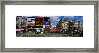 Commercial Signs On Buildings Framed Print by Panoramic Images