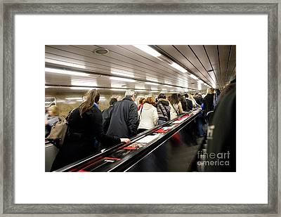 Commuters On Escalators In Prague Metro Framed Print by Mark Williamson