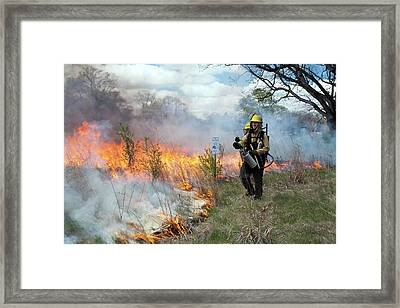 Controlled Fire Framed Print by Jim West