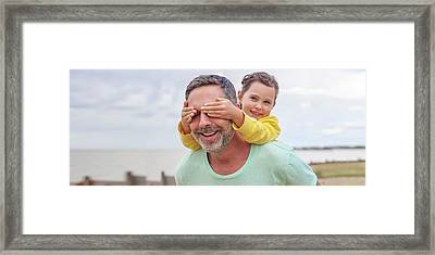 Daughter Covering Father's Eyes Framed Print by Ian Hooton