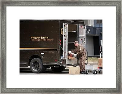 Deliver Driver Loading His Van Framed Print by Jim West