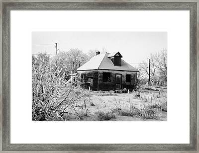 derelict empty wooden traditional house in rural village Forget Saskatchewan Canada Framed Print by Joe Fox