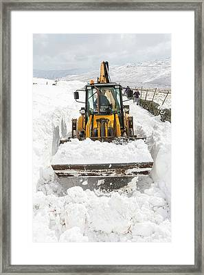 Digger Clearing Snow Drifts Framed Print by Ashley Cooper