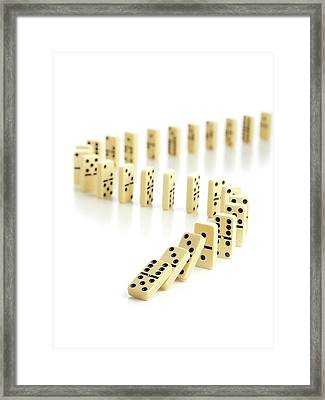 Dominoes Falling Down Framed Print by Science Photo Library