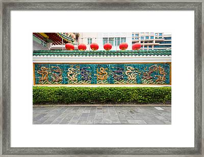 Dragon Frieze Outside A Building Framed Print by Panoramic Images