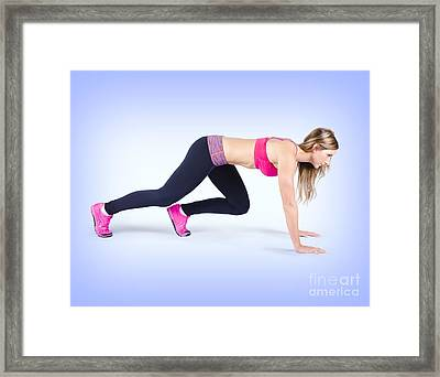 Female Track And Field Athlete Preparing To Run Framed Print by Jorgo Photography - Wall Art Gallery