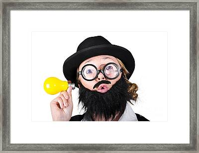 Female With A Funny Face Holding Light Bulb Framed Print by Jorgo Photography - Wall Art Gallery