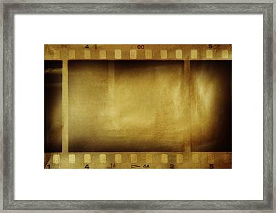Film Strips Framed Print by Les Cunliffe