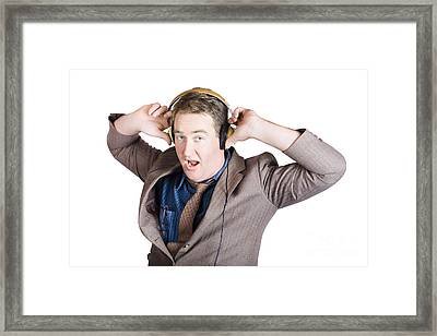 Funny Businessman Wearing Earphones On White Framed Print by Jorgo Photography - Wall Art Gallery