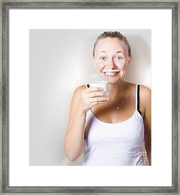 Funny Woman Smiling With Glass Of Full Cream Milk Framed Print by Jorgo Photography - Wall Art Gallery