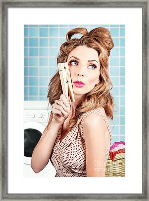 Gorgeous Pin-up Woman Holding Large Cleaning Peg Framed Print by Jorgo Photography - Wall Art Gallery