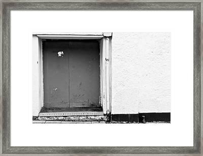 Grey Door Framed Print by Tom Gowanlock