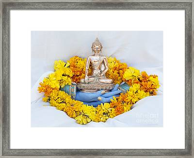 Hands Holding Buddha Framed Print by Tim Gainey