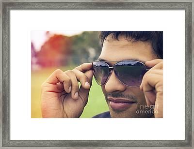Handsome Man Putting On Summer Eyewear Framed Print by Jorgo Photography - Wall Art Gallery