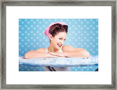 Happy 60s Pinup Housewife On Blue Ironing Board Framed Print by Jorgo Photography - Wall Art Gallery