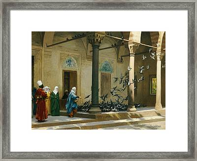 Harem Women Feeding Pigeons In A Courtyard Framed Print by Jean Leon Gerome