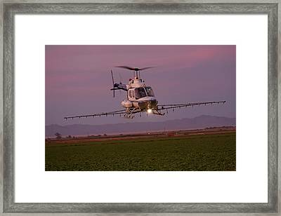 Helicopter Spraying Pesticides Framed Print by Jim West