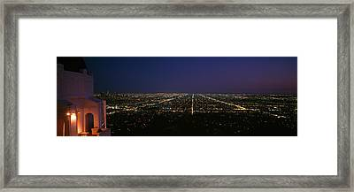 High Angle View Of A City At Night Framed Print by Panoramic Images