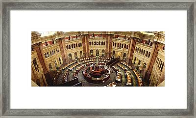 High Angle View Of A Library Reading Framed Print by Panoramic Images