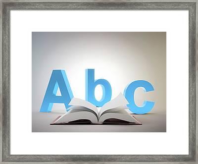 Learning The Alphabet Framed Print by Andrzej Wojcicki