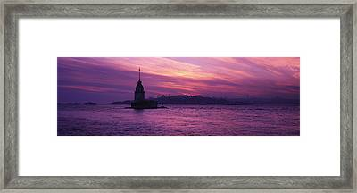 Lighthouse In The Sea With Mosque Framed Print by Panoramic Images