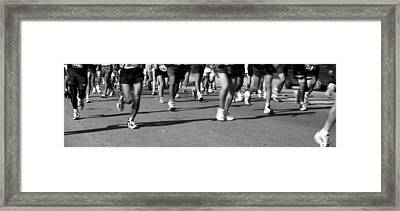 Low Section View Of People Running Framed Print by Panoramic Images