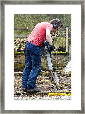 Man Breaking Concrete With A Jack Hammer Framed Print by Mark Williamson