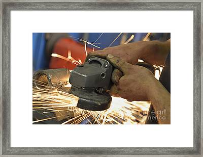 Man Cutting Steel With Grinder Framed Print by Sami Sarkis