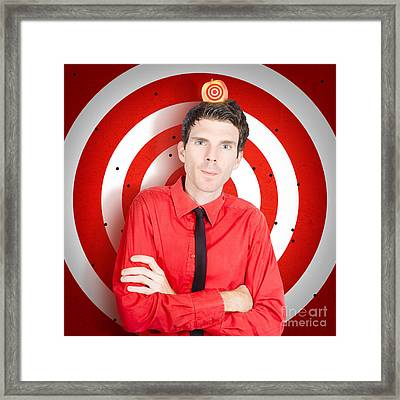 Man Standing In Front Of Target Sign With Apple Framed Print by Jorgo Photography - Wall Art Gallery