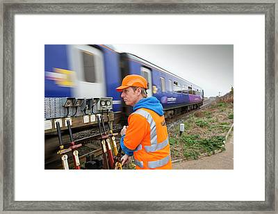 Man Switching Points At A Level Crossing Framed Print by Ashley Cooper