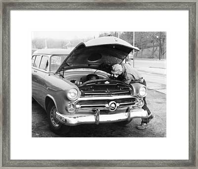 Man Working On His Car Framed Print by Underwood Archives