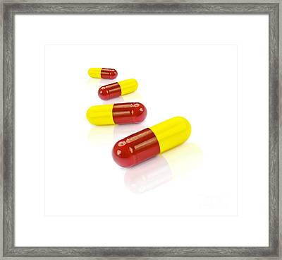 Medication Tablets On White Background Framed Print by Jorgo Photography - Wall Art Gallery