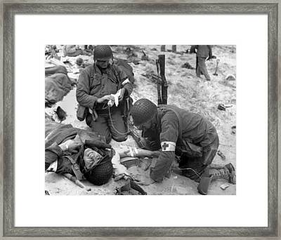Medics Treat A Wounded U.s. Soldier Framed Print by Everett
