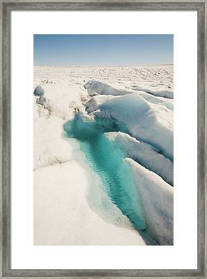 Melt Water On The Greenland Ice Sheet Framed Print by Ashley Cooper