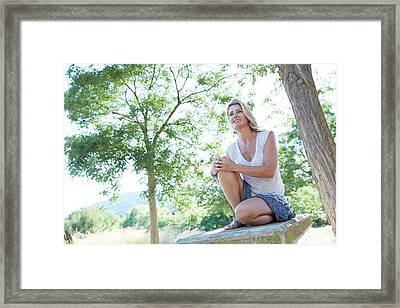 Mid Adult Woman Sitting Among The Trees Framed Print by Ruth Jenkinson
