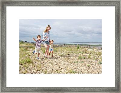 Mother And Children On Beach Framed Print by Ian Hooton