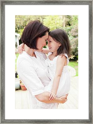 Mother And Daughter Hugging Framed Print by Ian Hooton