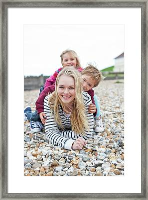 Mother With Children On Beach Framed Print by Ian Hooton
