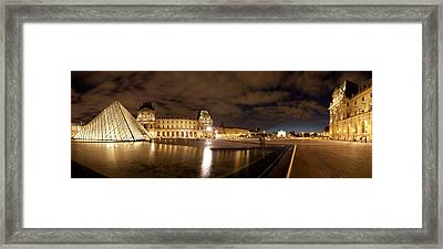 Museum With Glass Pyramid Lit Framed Print by Panoramic Images