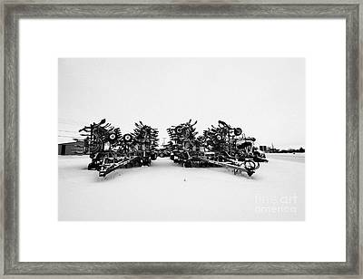 new bourgault 5710 air hoe drill covered in snow in winter Kamsack Saskatchewan Canada Framed Print by Joe Fox