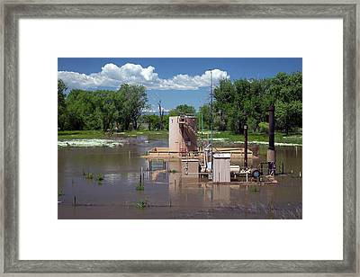 Oil Well Flooded By River Framed Print by Jim West