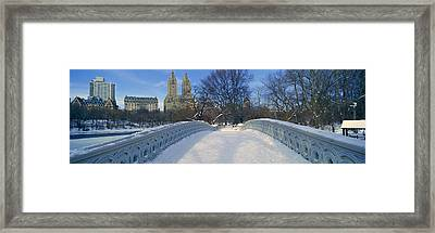 Panoramic View Of Bridge Over Frozen Framed Print by Panoramic Images