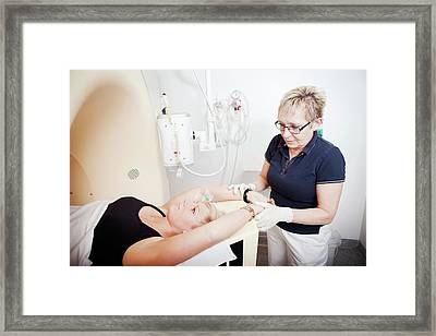 Patient In Ct Scanner Framed Print by Thomas Fredberg